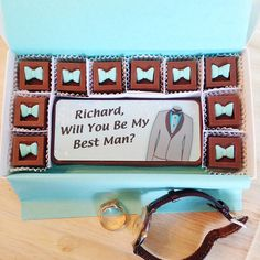"""Will you be my best man chocolates. Personalized Best Man Proposal. A unique way to ask your best friend to be a part of your wedding. Colorful edible best Man design is like giving your friend a card and chocolates. Includes 10 bow tie chocolates and one large chocolate bar measuring 2.25""""x5.75"""" and approx. 1/2"""" thick, over 1/2 lb, of chocolate altogether! By Diamond Chocolates"""