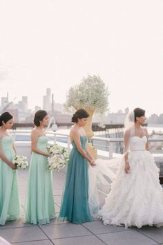 Maid of honor wears a different shade of the bridesmaid's dresses to stand out just a little