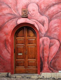 Colorful mural and door in Bologna, Italy