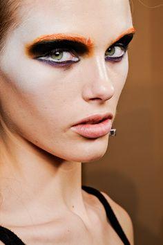 Orange and black greasepaint. Prada Fall 2012 by Pat McGrath.