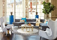 Jonathan Adler is not afraid of mixing and matching. This living room incorporates sculptural furniture like the Milano Wing Chair and Danner Curved Sectional (both in blue tonal velvets) that bring life to the room. Living Room Chairs, Living Room Interior, Living Room Furniture, Living Room Decor, Lounge Chairs, Living Rooms, Curved Sectional, Modern Sectional, Curved Couch