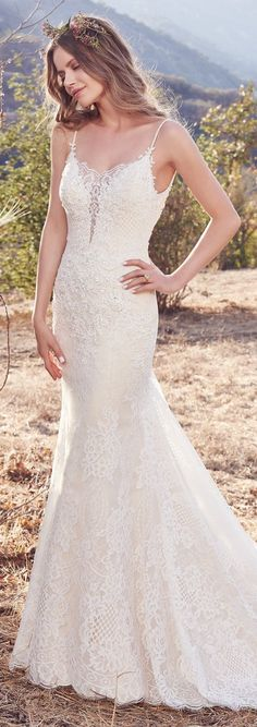 Maggie Sottero - IDA, This allover lace wedding dress sheath features sheer lace atop a plunging neckline, with delicate bead and Swarovski crystal accents along the bodice. Complete with beaded spaghetti straps and a scoop back trimmed in lace illusion. Finished with covered buttons over zipper closure. Tulle and lace veil sold separately.