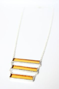 Yellow glass with nickle-free, sterling silver chain in a lead-free solder…