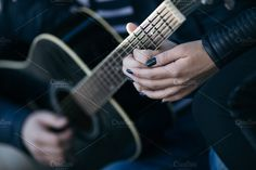Close up of hands playing guitar by DJ Photography on @creativemarket