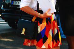 vibrant pleated skirt and killer bag.