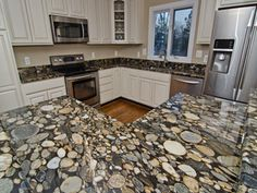 Bon Designing With River Rock And Black Mosaic Gold Granite Kitchen Countertops.  How Do