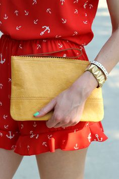 ruffle romper and yellow leather clutch