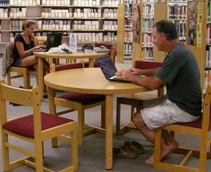 Vanessa and Doug enjoy bringing their laptops to the Library on a rainy day.