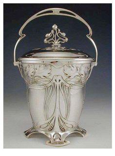 Another beautiful piece of Art Nouveau Silver ! Silver-plate on pewter & brass biscuit barrel with art nouveau floral decoration. Belle Epoque, Motifs Art Nouveau, Art Nouveau Design, Europa Art, Vintage Silver, Antique Silver, Jugendstil Design, Art Moderne, Arts And Crafts