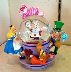 Disney Alice in Wonderland Spinning Snowglobe NEW Disney,http://www.amazon.com/dp/B005N29QUA/ref=cm_sw_r_pi_dp_w0lqsb12ZZTKS6QQ