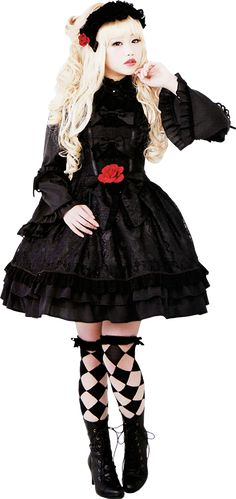 Typical Gothic Lolita, which seems like the polar opposite/staple dress style of Lolita in general (as opposed to sweet lolita). This is gorgeous, especially for the winter, with a bonnet!