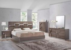 An+arresting+high+gloss+finish+surrounds+the+bed+and+case+pieces+of+the+Mariah+Queen+Bedroom+Collection.+Round+bump+outs+on+the+case+pieces+serve+as+the+drawer+pulls+and+continue+through+the+headboard.++Led+lights+illuminate+the+headboard+assuring+that+the+bed+will+be+the+eye-catching+centerpiece+of+your+bedroom.+Collection+includes+bed,+dresser,+mirror,+two+nightstands+and+chest.