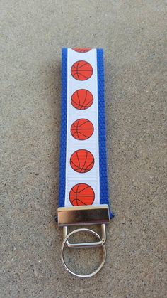 Check out this item in my Etsy shop https://www.etsy.com/listing/499885892/basketball-wristlet-keychain-on-blue