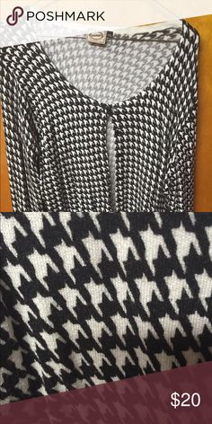 Modcloth houndstooth cardigan Euc size 2x Bought this from Modcloth but it's too big on me now since I lost weight. Cute black and white houndstooth cardigan, very classic, brand is Banned Apparel. Stretchy fabric, size 2x. Worn by me about 3-4 times so in gently used condition. I liked to wear this over brightly colored dresses, but you could style this so many ways! ModCloth Sweaters Cardigans