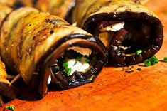 grilled eggplant spirals stuffed with goat cheese and chive mixture