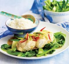 Steamed fish with ginger, chilli and hot sesame dressing. Super easy, healthy and delicious fish recipe. We tried just wrapping the fish in tinfoil instead of using a bamboo steamer and it worked fine.