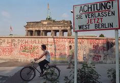 "A graffiti-covered section of the wall close to the Brandenburg Gate in Berlin in Sign reads: ""Attention! You are now leaving West Berlin"" East Germany, Berlin Germany, Fall Of Berlin Wall, Ddr Brd, Berlin Hauptstadt, Rare Historical Photos, After The Fall, Ancient Egyptian Art, Ancient Aliens"