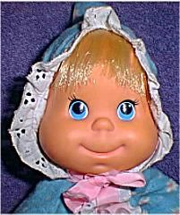 Mattel Baby Beans, I still have this exact doll. She has a pull string and talks.
