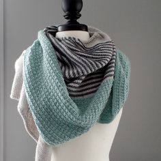 Pisgah is a bias, triangle shawl with a curved top edge, shaped by increases on one side and decreases on the other. The pattern begins with only a few cast-on stitches, and is worked sideways. A simple I-cord edge is worked simultaneously, and flows seamlessly into the I-cord bind off.