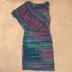 One Shoulder Dress Super comfortable one shoulder dress that hugs your body and falls where you need it to! 95% Polyester 5% Spandex. Offers are welcome! Dresses One Shoulder