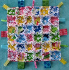 small rag quilt with taggies