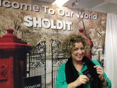 Coach Jenn Lee with a Clutch Wrap purse by SHOLDIT at the Atlanta Gift Show 2013