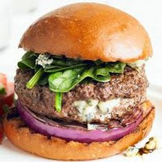 Stuffed Blue Cheese BEEF BURGER w/ red onions & spinach