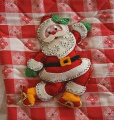 this Santa applique is all hand pieced together, including the cute face, which is embroidered, and trimmed with sequins and tiny beads.