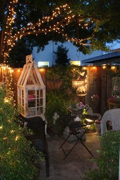 Inspiration for creating a retreat in a small yard - it's a bit busy for my taste but I love how cozy it is.