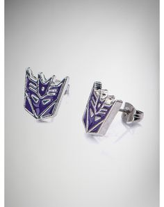 Party points to ME! I just found the Transformers Purple Decepticon Stud Earrings from Spencer's. Visit their mobile website to get this item and more like it.