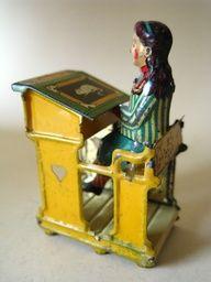 Meier Girl at School Desk penny toy, 1910, Germany. love. it.
