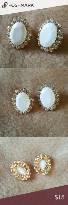 Rhinestones Earrings Brand new. Good tone. Oval shaped white stone with silver rhinestones. Hypoallergenic. Jewelry Earrings