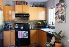 Melissa and Ramzy's Colorful, Creative & Comfortable Home - like the idea of the tiles under the bottom cabinets....