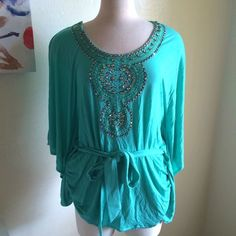 Beaded blouse Beautiful color! It's like a minty sea foam green. Rounded neckline. It has beads and embellishments on the front. It ties around the front or back for a flattering shape. Very soft and stretchy. 100% rayon. Can fit 2x as well. INC International Concepts Tops Blouses