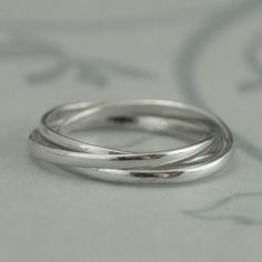 Rolling ring - could try a combination of brushed and polished gold