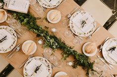 Rustic Table Setting with greenery garland centrepiece and vintage china | Laura de Sagazan boho wedding dress | Destination wedding in Spain | Outdoor ceremony | al fresco dining | Image by Marcos Sánchez | http://www.rockmywedding.co.uk/laura-david/