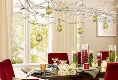 A beautiful chandelier of white twigs and golden Christmas balls. A perfect centerpiece for the dinner table. You can also easily do this craft on your own.