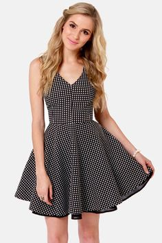 Check it out from Lulus.com! Black and white stripes are more than all right, but the In Spot Pursuit Black Polka Dot Dress is worth making a mad dash for! This beautifully constructed dress has white polka dots over a black woven material with a V-neckline and a flirty, plunging V-back. Darted bodice is finely fitted and a full circle skirt completes this retro-fabulous look. Invisible back zipper/hook clasp. Fully lined. Model is wearing a size small. Shell: 62�0Polyester, 38�0Cotton…