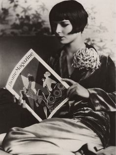 More Louise Brooks, this time with a book. Someone's got to rock that bob.