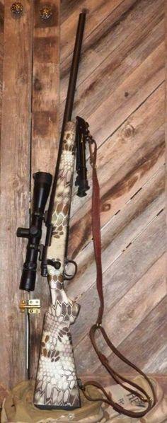 Kryptek Highlander camo'd out rifle.