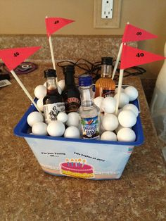 Bucket of Balls! used white gumballs as golf balls & favorite liquor. Made for friends 40th bday, Fore tee birthday gift for golfer! Being 40 takes balls!