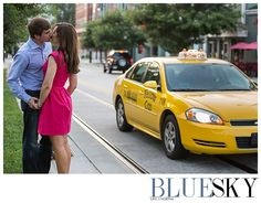 Uptown Charlotte, NC engagement session featuring a couple kissing by yellow cab.  www.weddingbybluesky.com
