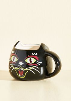 Mere Sipper-stition Mug. Whether you believe they bring good fortune or bad luck is up to you, but you can be certain this ceramic mug will add some great style to your kitchen. #black #modcloth
