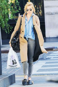 Sienna Miller wears a button-down top, camel coat, skinny jeans, round sunglasses, and Gucci backless loafers #guccidiscount