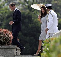 The Duchess of Cambridge talks to Group Captain Coombes as Prince William walks on ahead.