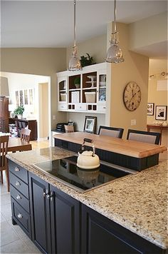 Dramatic Kitchen Makeover~Before and After -  love the island in a contrasting color of cabinets