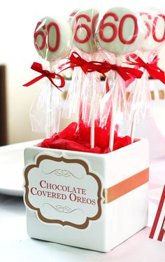 Mmmm Chocolate covered oreos - good party favor idea!  For dads 60th?
