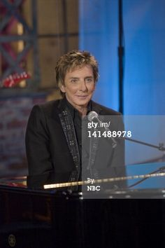 Barry Manilow at the piano.