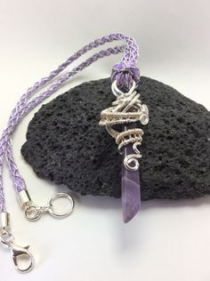 A personal favourite from my Etsy shop https://www.etsy.com/uk/listing/449390458/amethyst-wire-wrapped-pendant-necklace