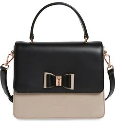 A chic mix of textured and smooth leather showcases this structured silhouette of a versatile satchel fitted with an optional strap and finished with a signature Ted Baker bow.